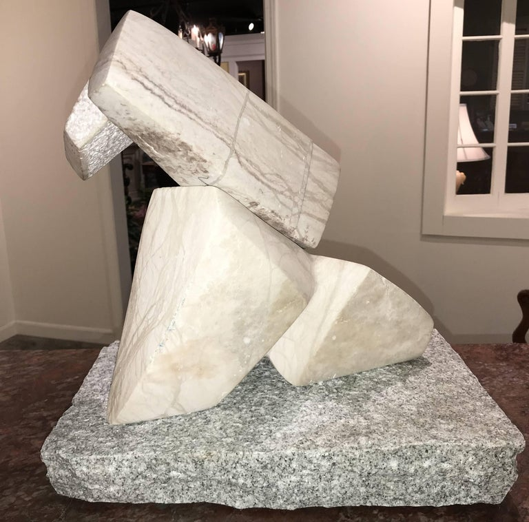 A fine modernist abstract carved variegated white marble sculpture, unsigned, and mounted on a rectangle granite plinth, with some sides left with rough finish, while others are polished. Great overall patina and a wonderful addition to your modern