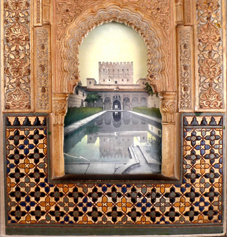 UNKNOWN ARTIST Spanish, Early 20th Century ALHAMBRA FACADE MODEL PLAQUE polychromed stucco plaque 11 x 7 inches (28 x 17.8 cm.) framed: 17-1/2 X 13-1/2 inches (44.5 x 34 cm.)  PROVENANCE Private Collector, Madrid  A Model of a Facade of the Alhambra