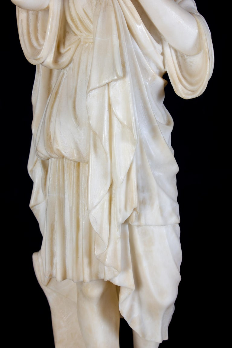 The sculpture is a marble representation of a draped Vestal Virgin, the priestesses of Vesta, goddess of hearth and home, whose duty it was to keep a sacred fire burning in her temple in Ancient Rome.
