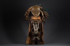 Ambete Reliquary Figure with Feathers