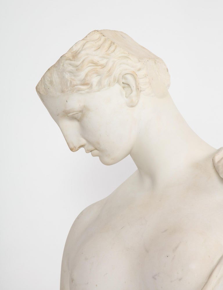 An Antique Italian Neoclassical Marble Bust of Psyche, by Giuseppe Carnevale, Rome, 19th century.  Very decorative bust of a male with half a head Psyche of Capua.  Signed G. Carnevale, with address in Rome.  Good condition. Normal wear consistent