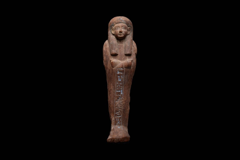 A beautiful ancient Egyptian shabti – the only surviving example known for Iweferbaku, dating to the 18th Dynasty, 1550-1295 BC. Carved in wood, with finely modelled facial features.  The Osiris is shown mummiform, wearing a tripartite wig with
