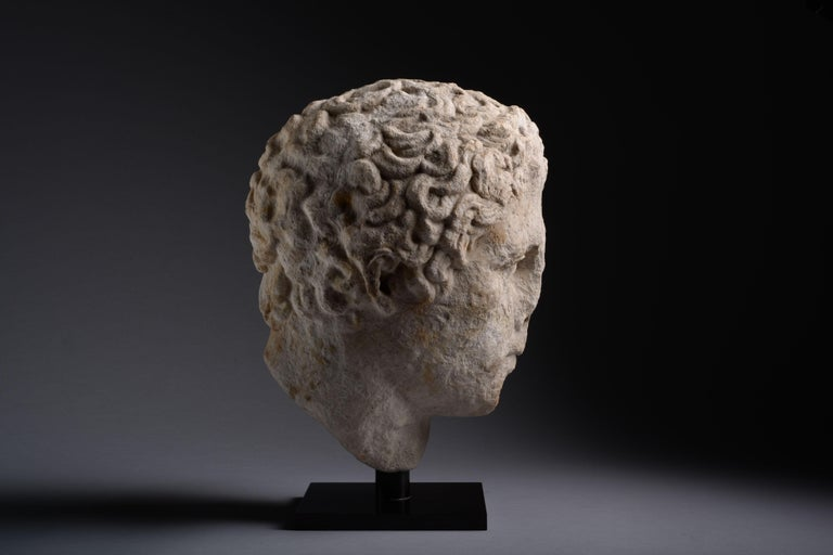 Ancient Greek Hellenistic Marble Head of an Athlete - Black Figurative Sculpture by Unknown