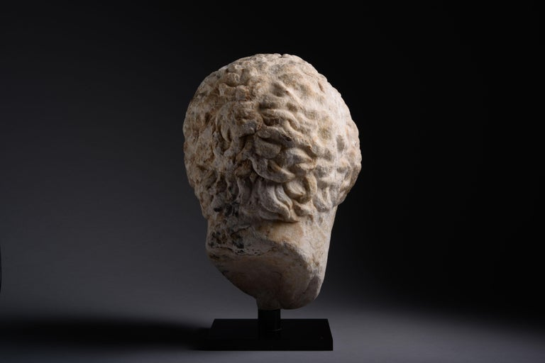 This powerful piece of Hellenistic sculpture is full of pathos. It depicts the idealised head of an athlete, with hair arranged in short locks around a broad forehead and expressive, deeply set eyes.  Athletic prowess was highly valued by the