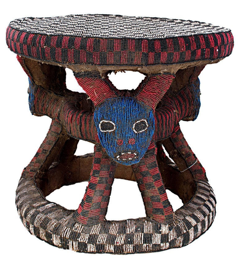 This stool, made by an unknown artist of the Bamoum tribe in Cameroon, was made from wood, cloth, & beads and was used by a cattle owner.   16 1/2