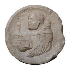 Bas-relief depicting Saint Dominic of Guzman