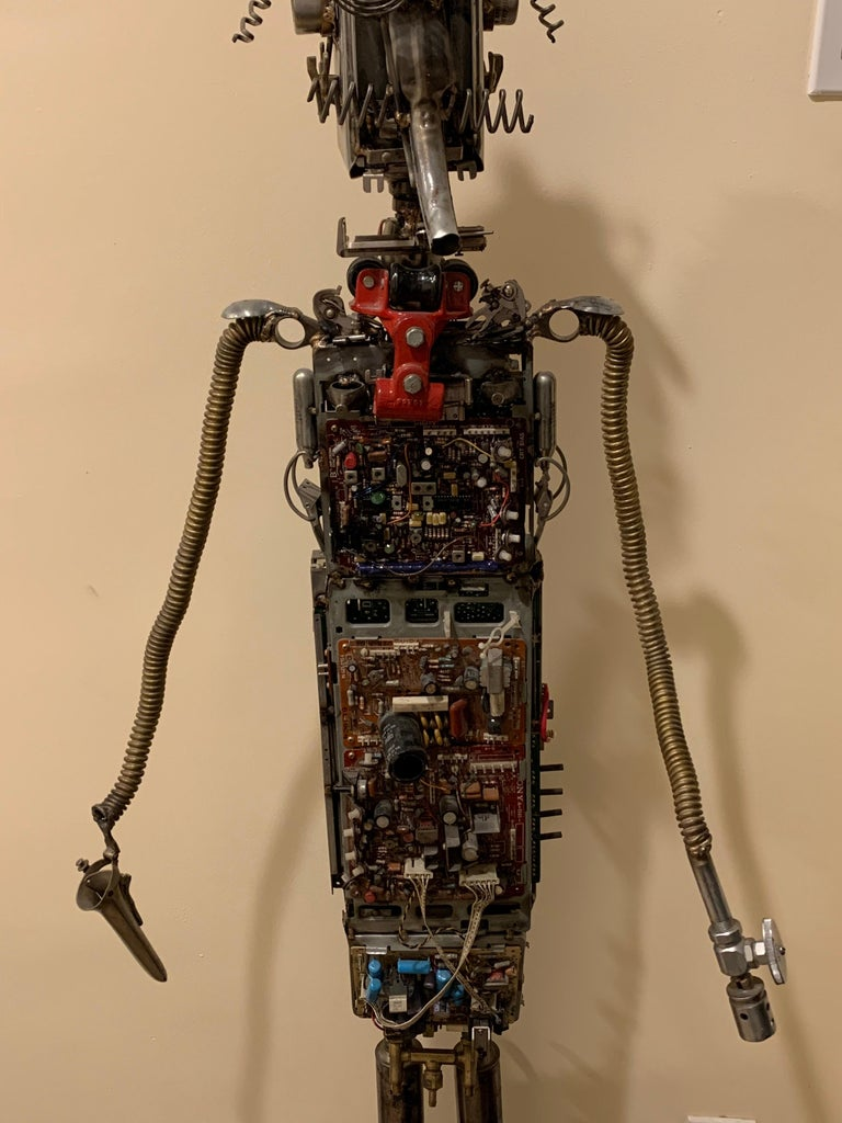 Sculpture created primarily from circuit boards with coils, tubes and plumbing fixtures. He is quite a handsome guy!