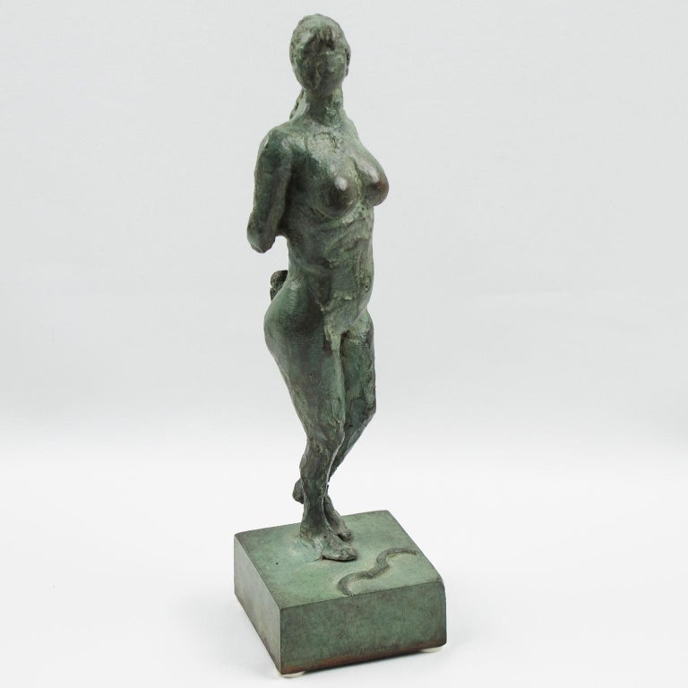 Stunning French Art Deco bronze sculpture figurine featuring a stylized free interpretation of Artemis or Diana The Huntress (Diane Chasseresse). The nude female has a handmade feel textured pattern design with both arms behind her back. The bow is