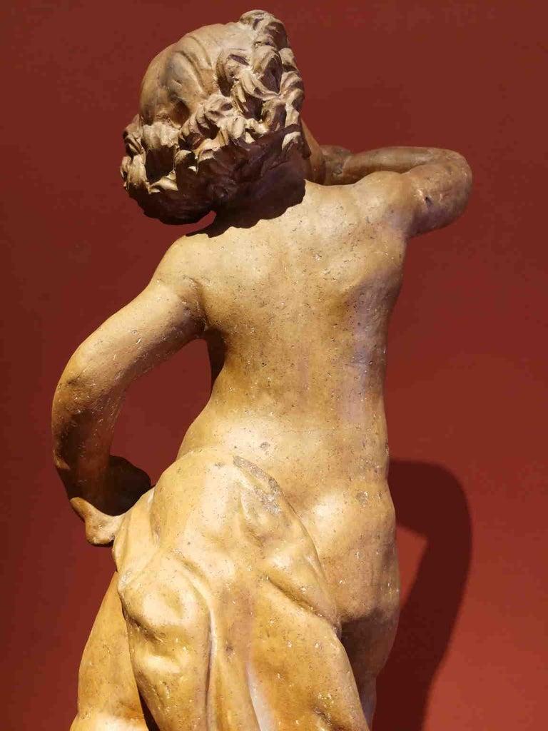 Florentine artist After Verrocchio, Putto, 17th, terracotta - Sculpture by Unknown