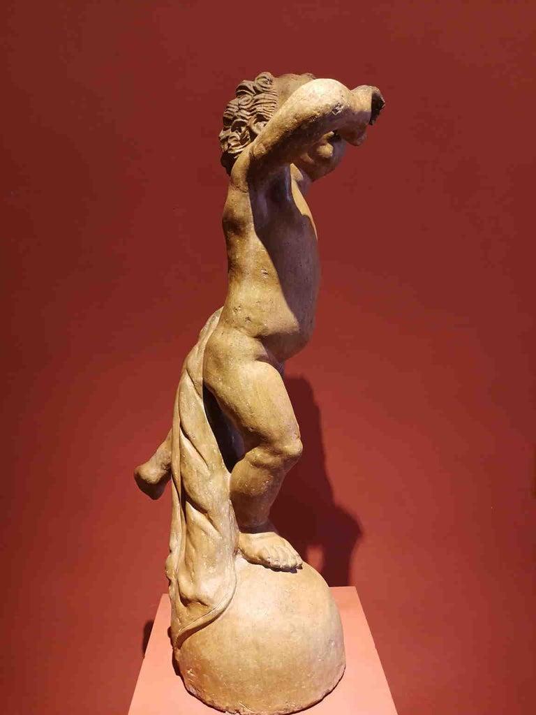 Florentine artist After Verrocchio, Putto, 17th, terracotta - Renaissance Sculpture by Unknown