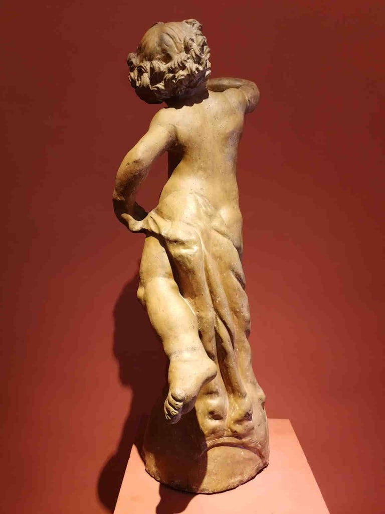 This putto is clearely inspired by the putto with dolphin by Andrea del Verrocchio, made for a fountain in Palazzo Vecchio (Florence). Also our putto was used as the top of a fountain, has we can clearely understand by the fact that is empty inside.