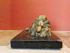 French Manufacturer, lion paperweight, 19th gilded bronze and marble
