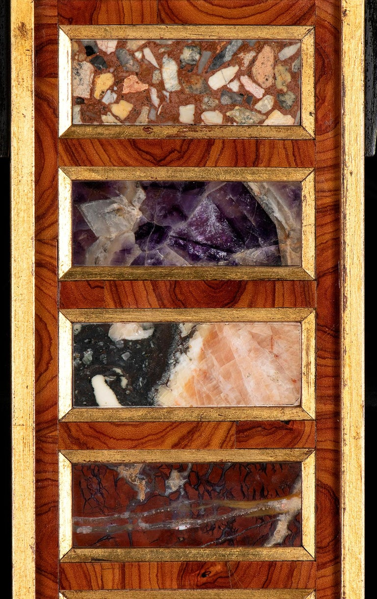an elegant collection of specimen and rare marbles framed with a neoclassical relief sculpture on the top. The collection of twelve