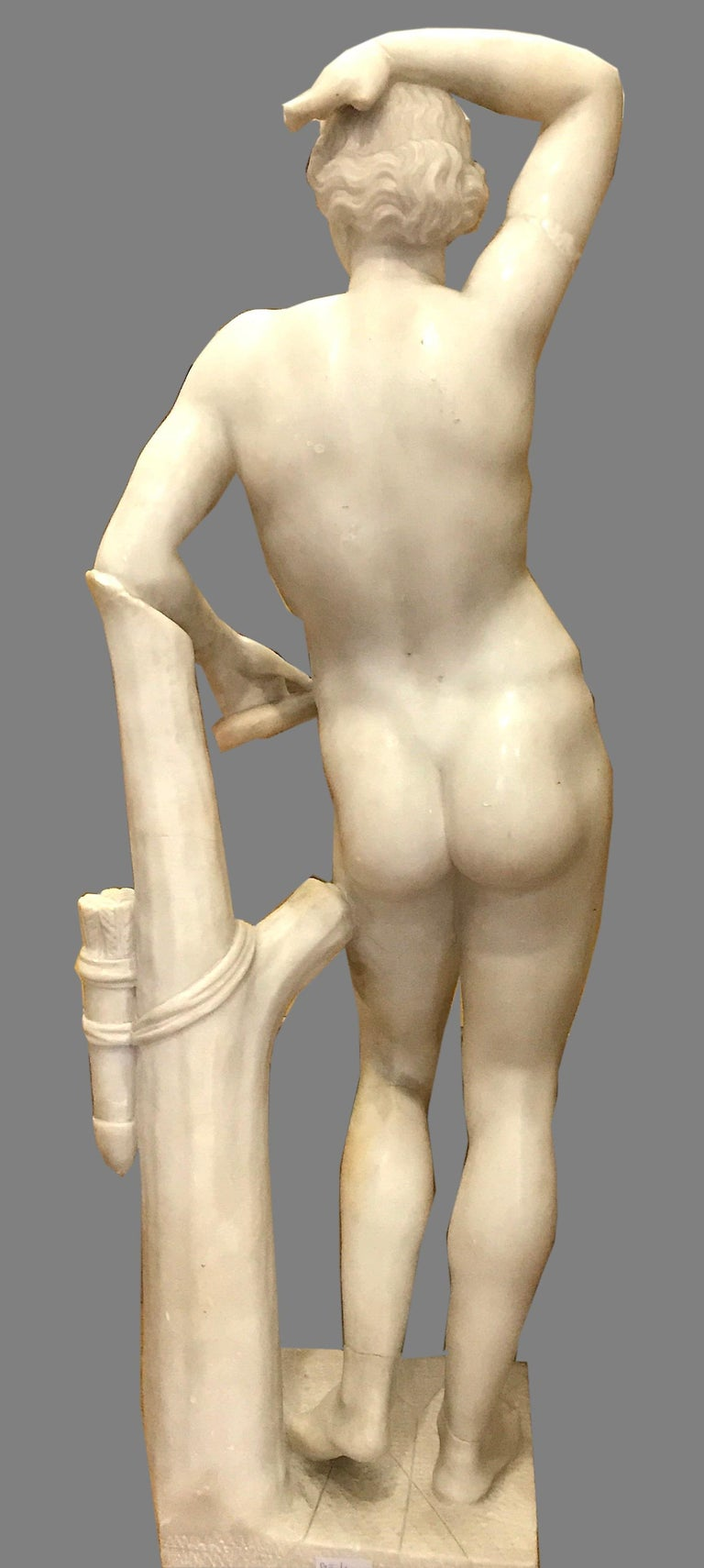 A 19th century Italian finely carved alabaster marble figure of Apollino, after the Antique . Figure standing and leaning against a tree trunk on square base . Ancient restorations.