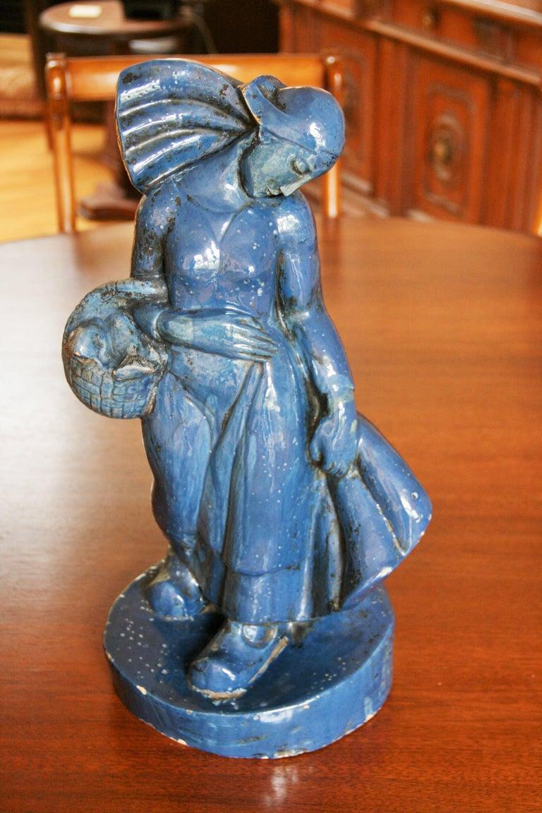 8-289 Italian terracotta sculpture with a cerulian blue glaze