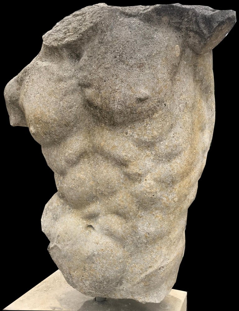 This reproduction of a classical Hellenistic sculpture, a timeless piece for interior and a garden decoration. Measurement: Torso cm 100 base cm 70.