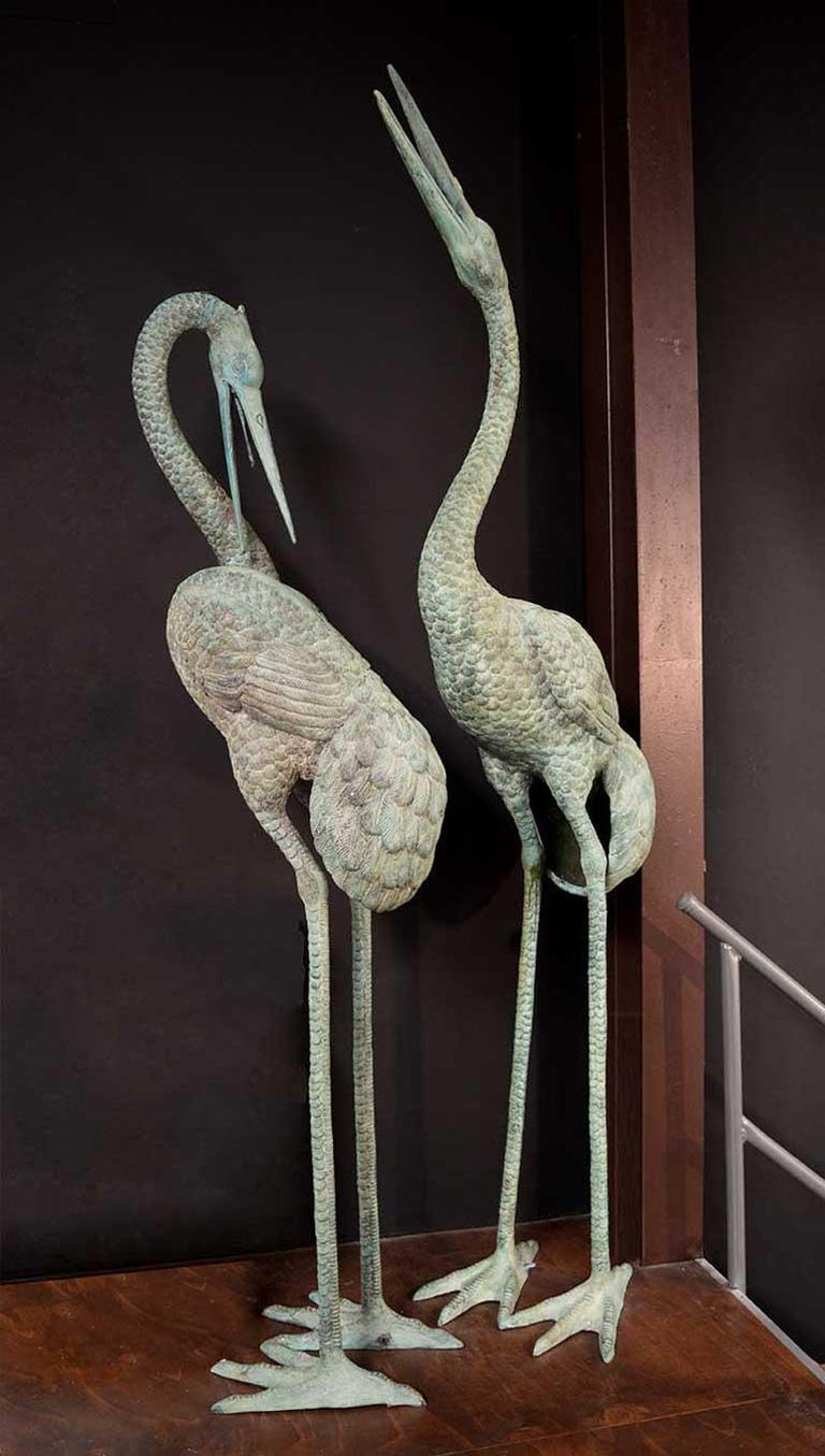 Standing almost 3 meters high, this set of beautifully detailed bronze cranes are not only sculptural pieces, but also double as a water feature for your pond or pool. With hose fittings on the feet of both birds, the water comes through and out of