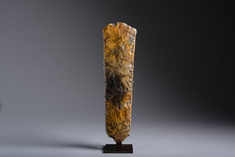 This tactile stone tool was finely knapped from a large piece of mottled orange and black flint, with beautiful marks resembling stitching along the edges, and has a thick old collection patina.  It was crafted in Sweden during the Neolithic