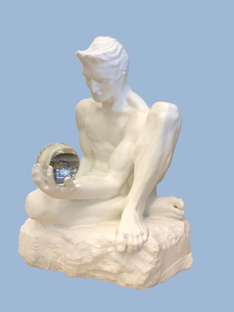 Man With A Crystal Ball In His Hand - Modern Sculpture by Unknown