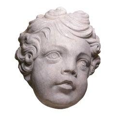 Marble head of a putti, circa 1700