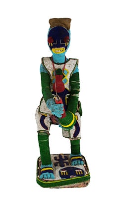 """Medicine Man""--African Wooden Sculpture with Glass Beads, Cloth, Bell, & Shells"