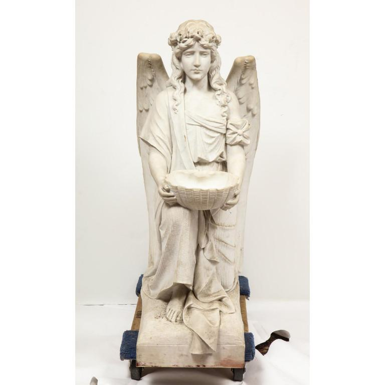 Monumental Italian white marble figure sculpture of a seated winged woman, Rome, 1870.  Depicting a seated female winged woman, holding a basket bowl on base.  Extremely finely carved by a master Italian sculptor.  Measures: 45