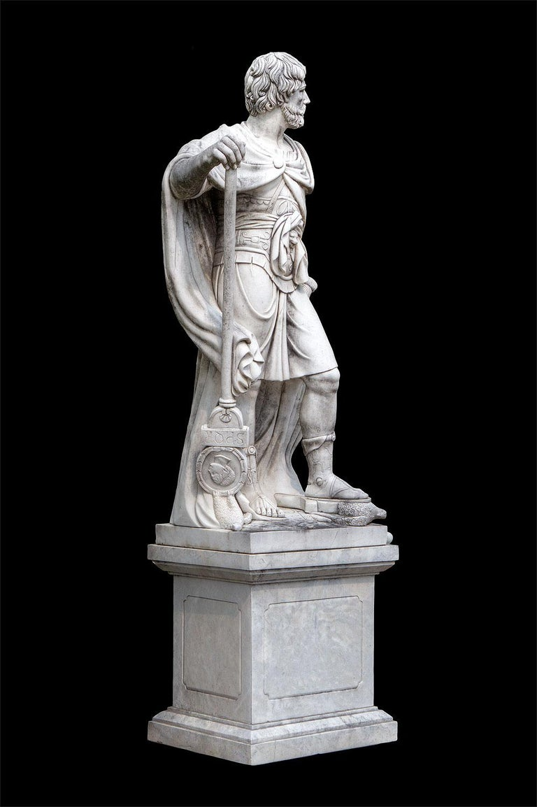 Standing figure of Julius Caesar wearing a Tunic and holding a billowing drapery with a composition marble square-section pedestal. . The other figure is of Hannibal.  Provenance from a Nord- Italian estate.  Base: H 85 cm, lxp=80x65 cm  Sculpture
