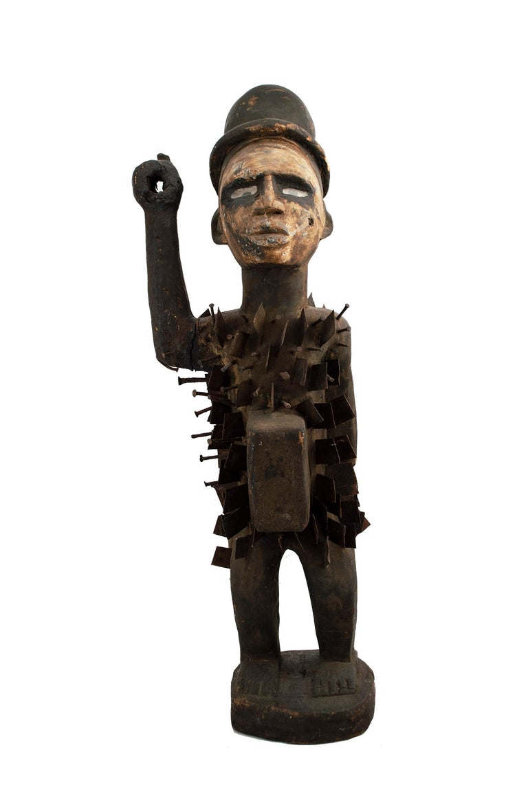 """Unknown Figurative Sculpture - """"Nail Fetish Bacongo-Zaire,"""" Glass, Wood, & Metal created circa 1910"""