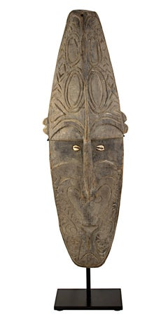 """Face Mask,"" Wood and Cowry Shells created in New Guinea circa 1940"