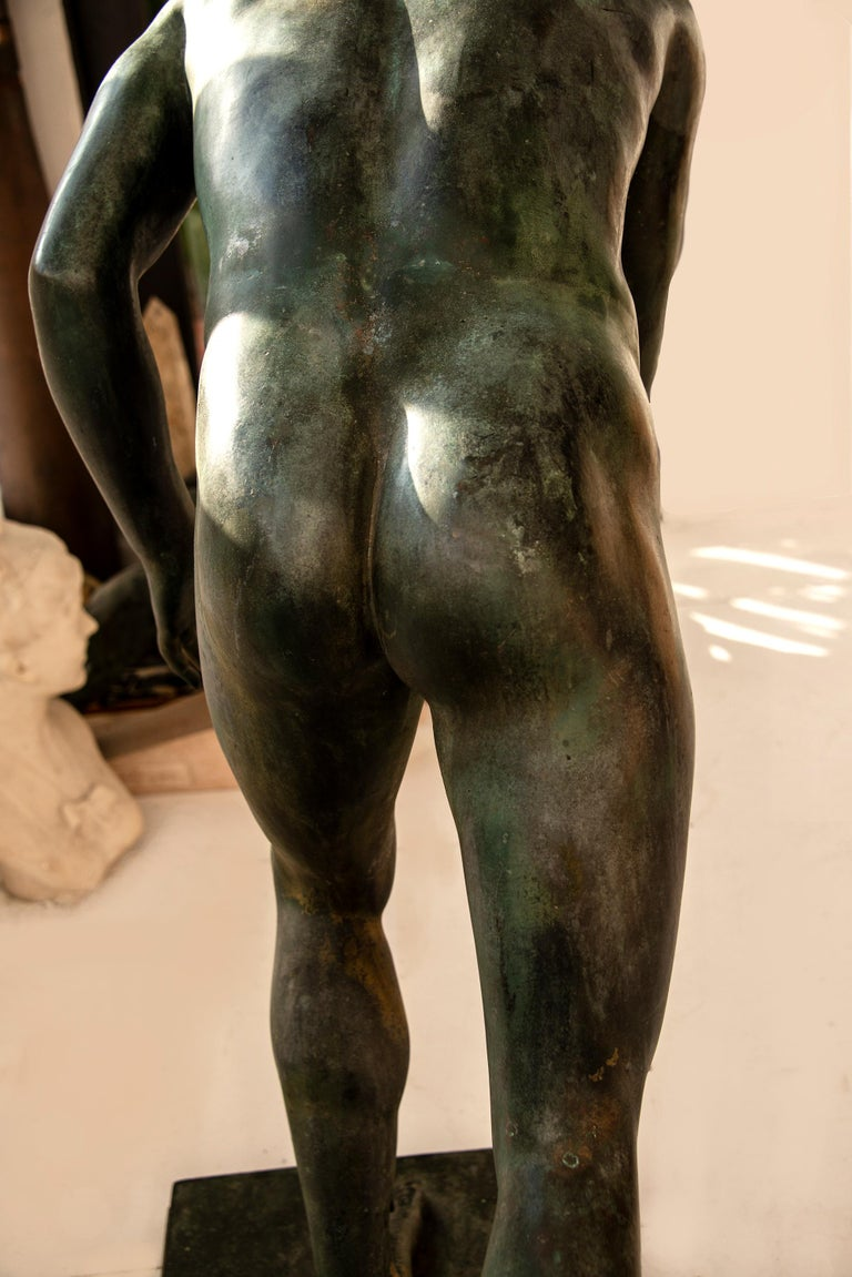 Beautifully proportioned and handsome nude male bronze with Roman classically refined features after the Antique .  It looks best with a key lighting that accents the shape and silhouette of the figure.