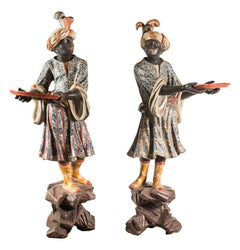 Pair of lacquered and painted wood blackamoor sculptures. Venice, 18th century