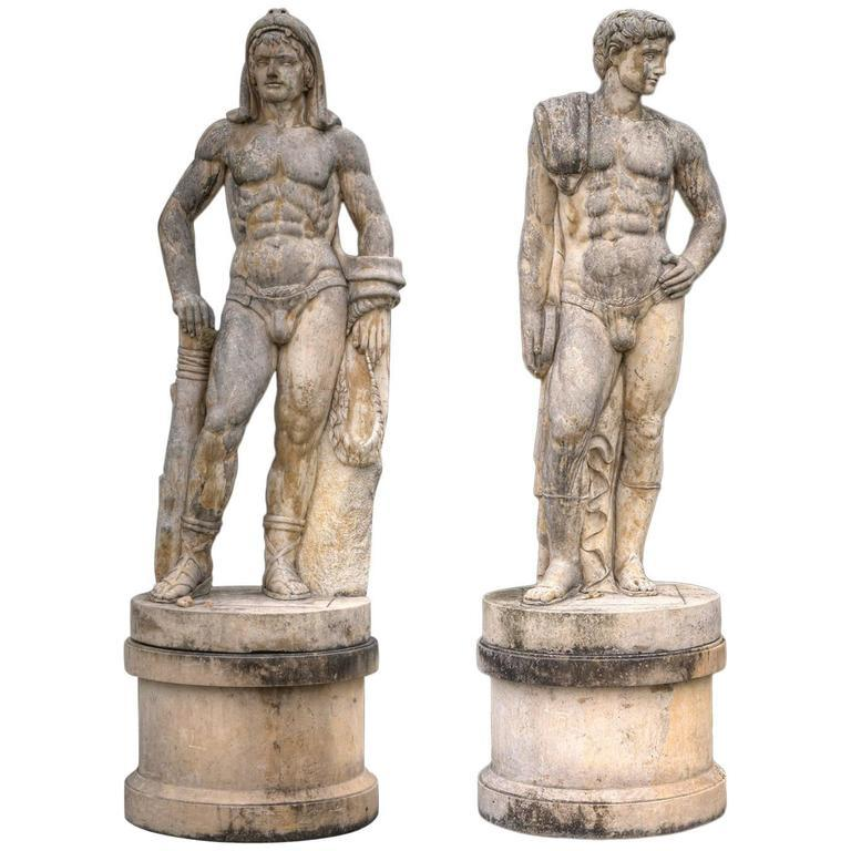 """This monumental pair of sculptures in """"Bardiglio"""" marble represent Greek Athlete of Discobolo and the Hercules figure with a lion pelt, on a cylindrical base . Exaltation of the male strength and beauty   Weight of each 1200 kg"""
