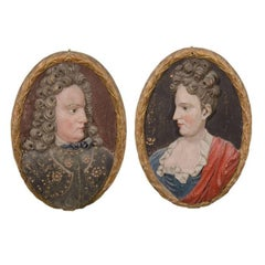 Pair of Wooden Plaques Depicting a Man and Woman, Carved ca. 1700's