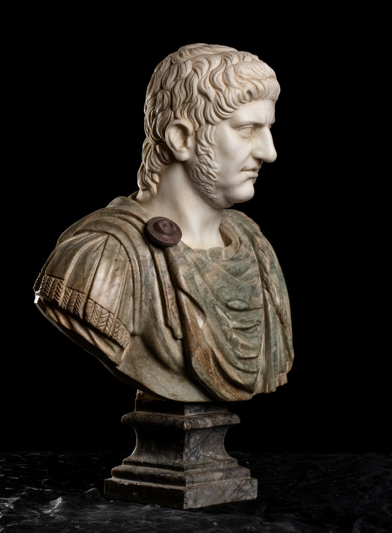 a superb and impressive sculpture carved in a rare and specimen selection of marbles: Statuary white marble for the head of the emperor Nero, a Cipollino green Marble for the armor and the elegant Grey Bardiglio for the base. Created in grand tour