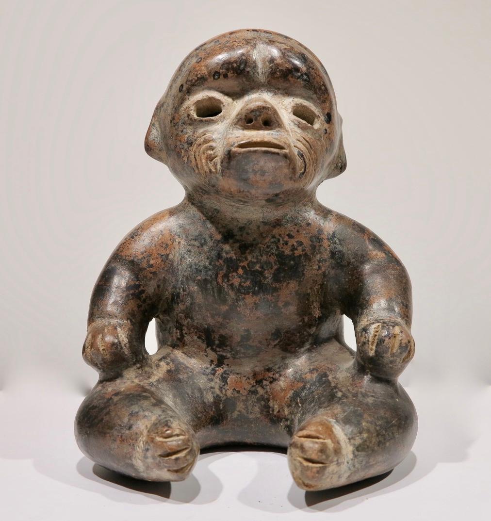 Pre-Columbian, Western Mexico, Colima Seated Dwarf figural redware sculpture