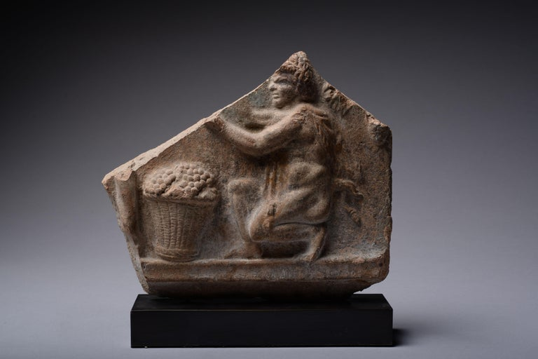 Unknown Figurative Sculpture - Roman Campana Relief of a Satyr Harvesting Grapes