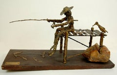 signed illegibly; Fisherman and Bird; bronze, wood, rock