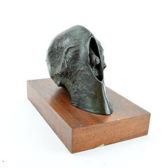 """Skull"", bronze sculpture on wood base"