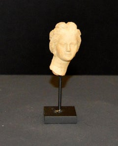 Terracotta small head of a goddess. Hellenistic period, III-I century BC.