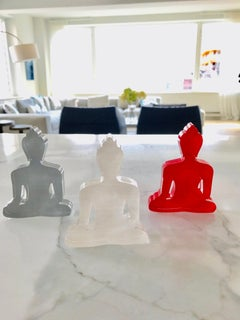 Three Buddhas - White, Red and Grey Buddha sculptures