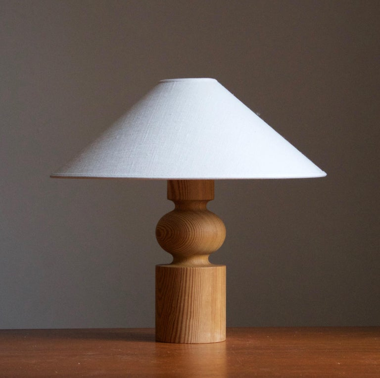 A sculptural solid pine table lamp. Designed by Uno Kristiansson, for Luxus, Sweden, 1970s. Branded.  Stated dimensions exclude lampshade, height includes socket. Sold without lampshade.  Other designers of the period include Axel Einar Hjorth,