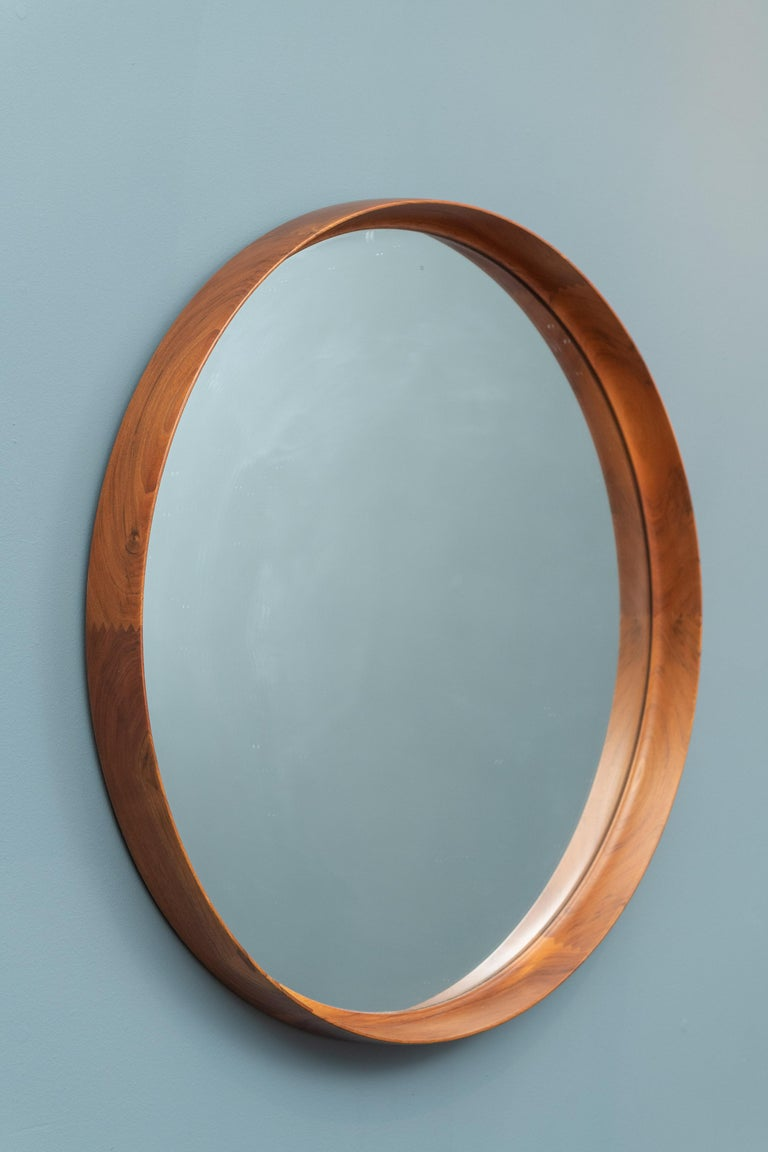 Rare large size teak wall mirror designed by Uno & Osten Kristiansson, Sweden.