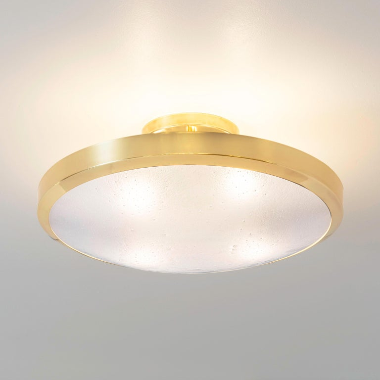 "The Uno ceiling light by form A exemplifies simple elegance via its clean profile designed around a single Murano glass shade. Shown in polished brass with our signature Murano bubble glass. Starting from $1,900.00 for the 10"" diameter"