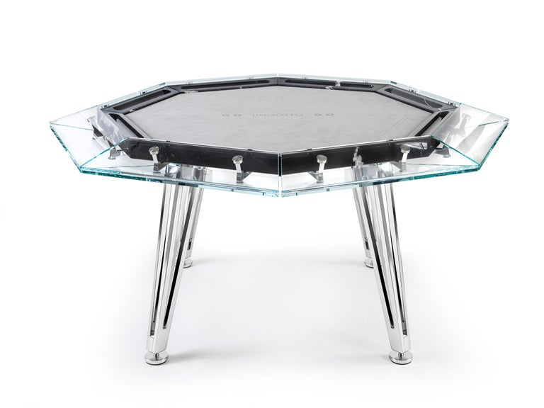 Unootto is the reinterpretation of the traditional professional poker table, making the A-game stylish and sophisticated.  This one of a kind octagonal poker table features a unique low-iron glass top edge supported by an inner black marble top,