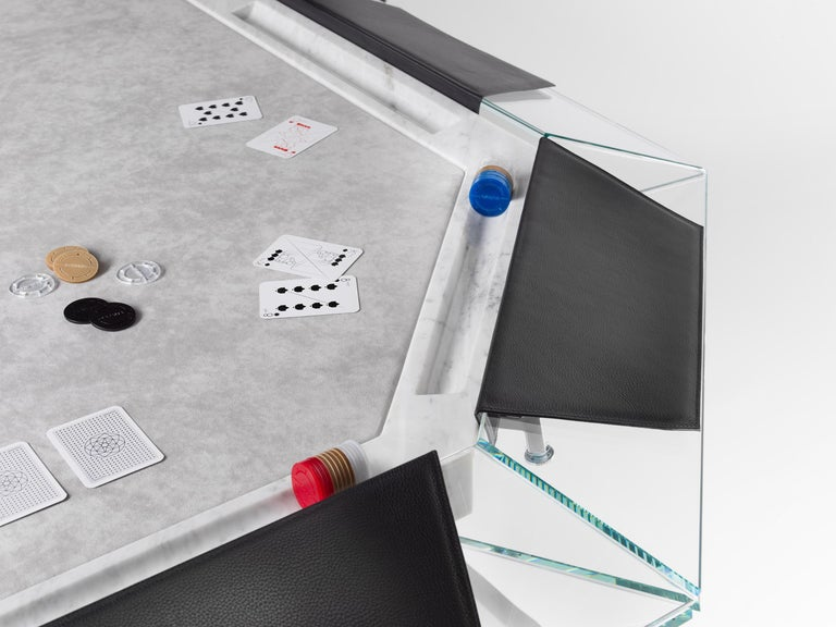 Unootto is the reinterpretation of the traditional professional poker table, making the A-game stylish and sophisticated.  This one of a kind 10 player poker table features a unique high-clarity glass top edge supported by an inner Italian marble
