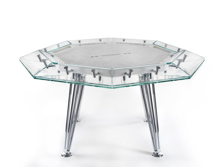 Unootto is the reinterpretation of the traditional professional poker table, making the A-game stylish and sophisticated.  This one of a kind octagonal poker table features a unique low-iron glass top edge supported by an inner Italian marble top,