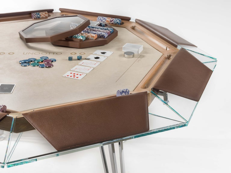Unootto is the reinterpretation of the traditional professional poker table, making the A-game stylish and sophisticated.  This one of a kind octagonal poker table features a unique low-iron glass top edge supported by an inner ashwood tabletop,
