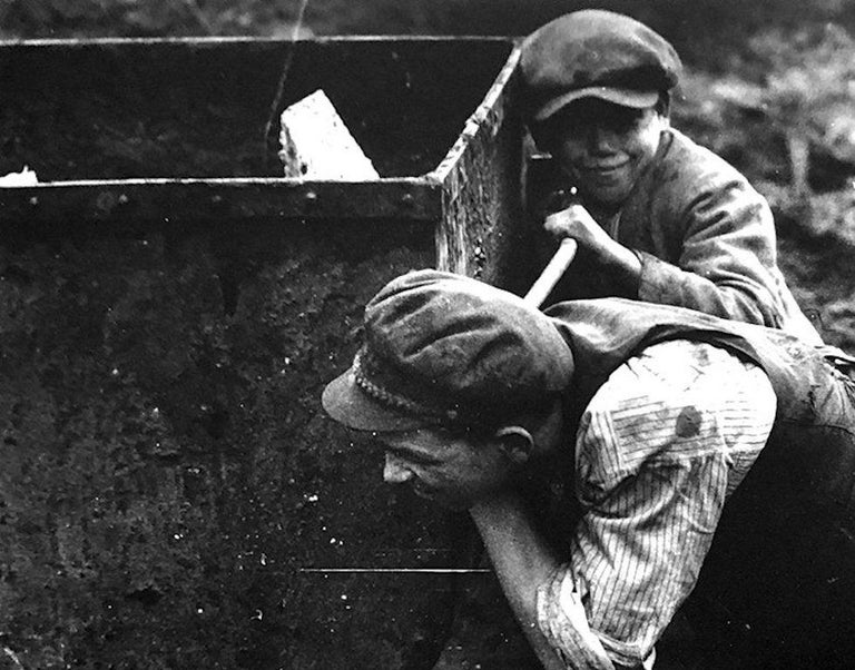 Youngboys pushing wheel barrel by Martin Munkacsi Silver Gelatin Print Image size: 9.63 in. H x 12.75 in. W Sheet size: 12 in. H x 15.5 in. W Stamped on verso 'copyright Estate Martin Munkacsi'  Martin Munkácsi (born Mermelstein Márton; 18
