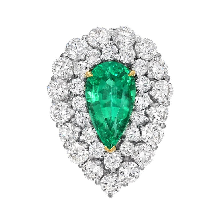 Colombian Emerald ring featuring a 5.31 carat pear shape, untreated, natural Emerald, nestled in a statement vintage platinum ring with diamonds. AGL gem certificate is attached in the image scroll for your convenience. Size 9.25. Resizing is