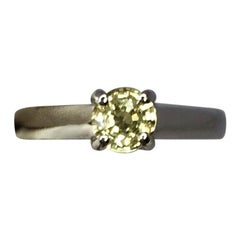 Untreated Light Yellow Sapphire 0.63 Carat Solitaire Platinum Crossover Ring